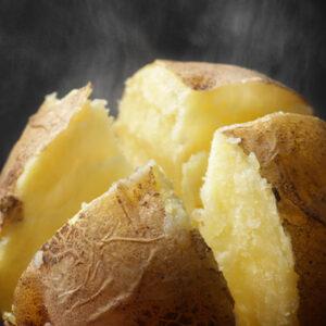 Steaming yellow baked potato